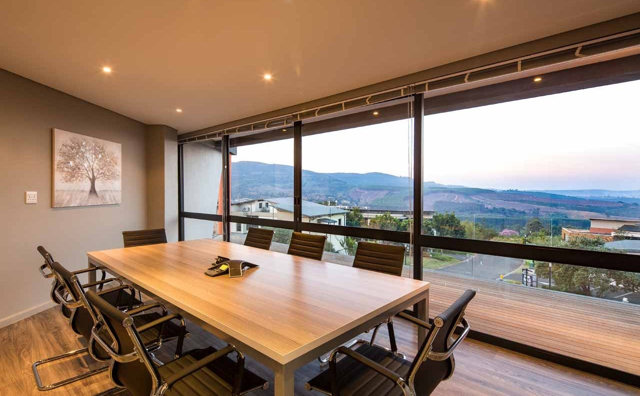 A stylish meeting room with a view out into a green neighbourhood